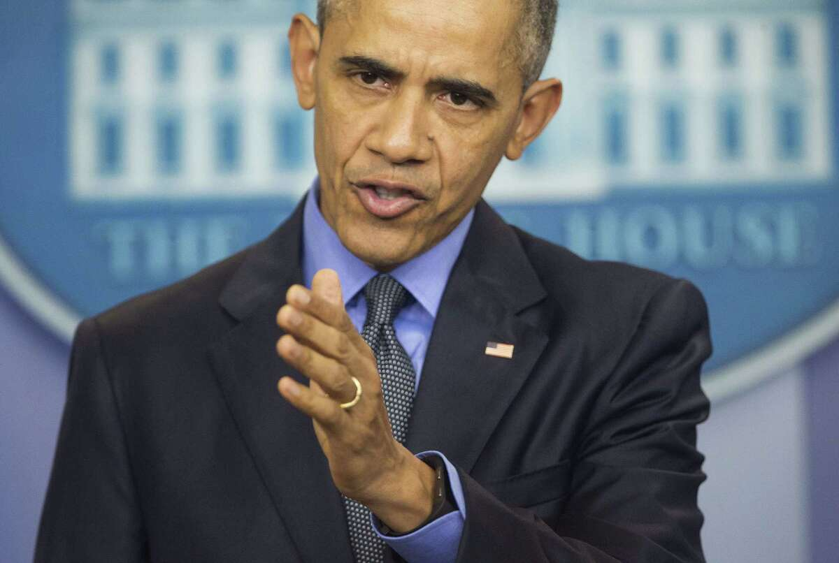President Barack Obama speaks during a news conference in the White House Brady Press Briefing Room in Washington, Friday, Dec. 18, 2015. (AP Photo/Pablo Martinez Monsivais) ORG XMIT: DCPM108
