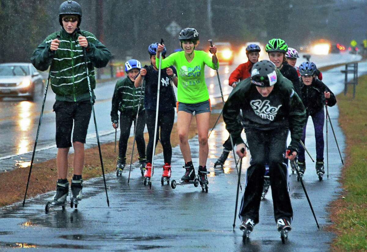 Without snow, the Shen ski team practices on roller skis on the sidewalk along Moe Road Thursday Dec. 17, 2015 in Clifton Park, NY. (John Carl D'Annibale / Times Union)
