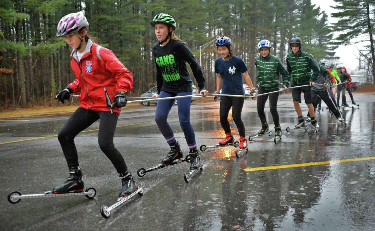 Without snow, the Shen ski team practices on roller skis at the school Thursday Dec. 17, 2015 in Clifton Park, NY. (John Carl D'Annibale / Times Union)