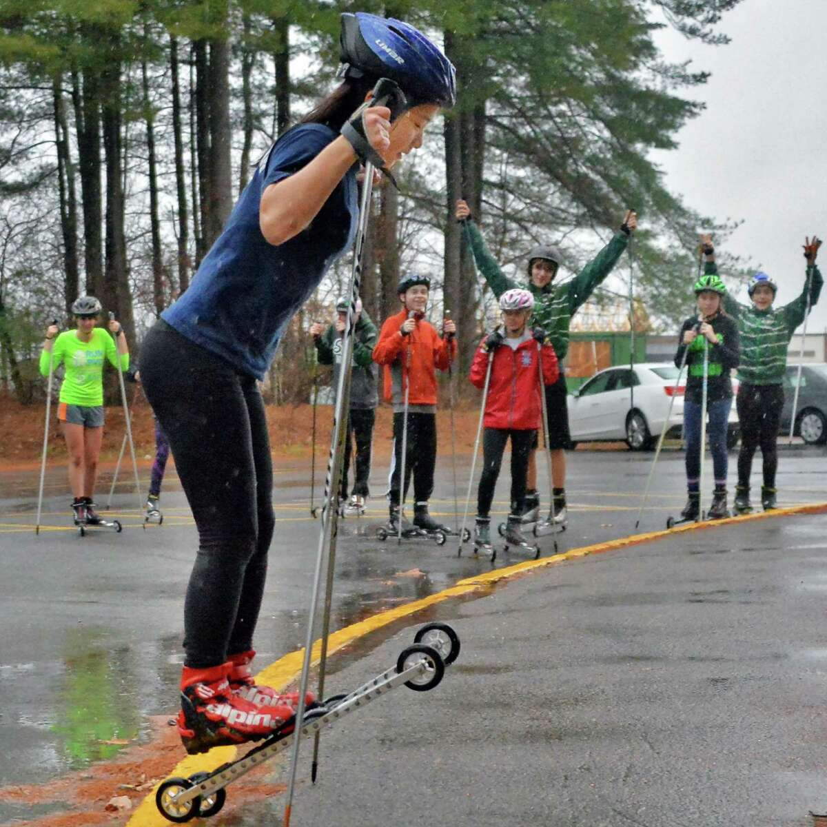 Sohyun Park practices a jump on roller skis as the team practices at the school Thursday Dec. 17, 2015 in Clifton Park, NY. (John Carl D'Annibale / Times Union)