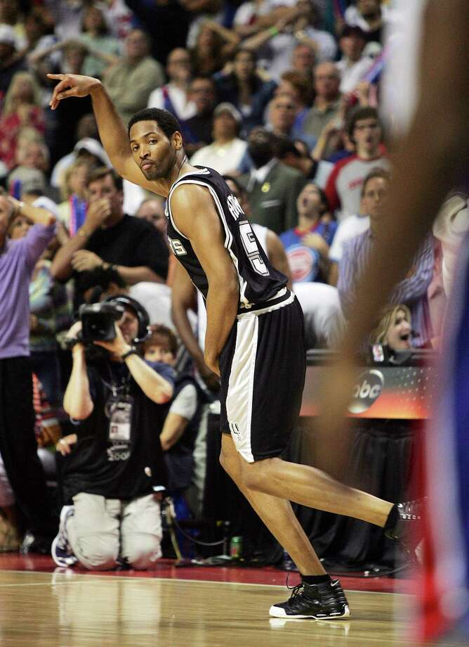 Spurs' Robert Horry gestures after hitting the winning 3-pointer during overtime of Game 5 of the NBA Finals against Detroit in 2005. Photo: Kin Man Hui /San Antonio Express-News / SAN ANTONIO EXPRESS-NEWS