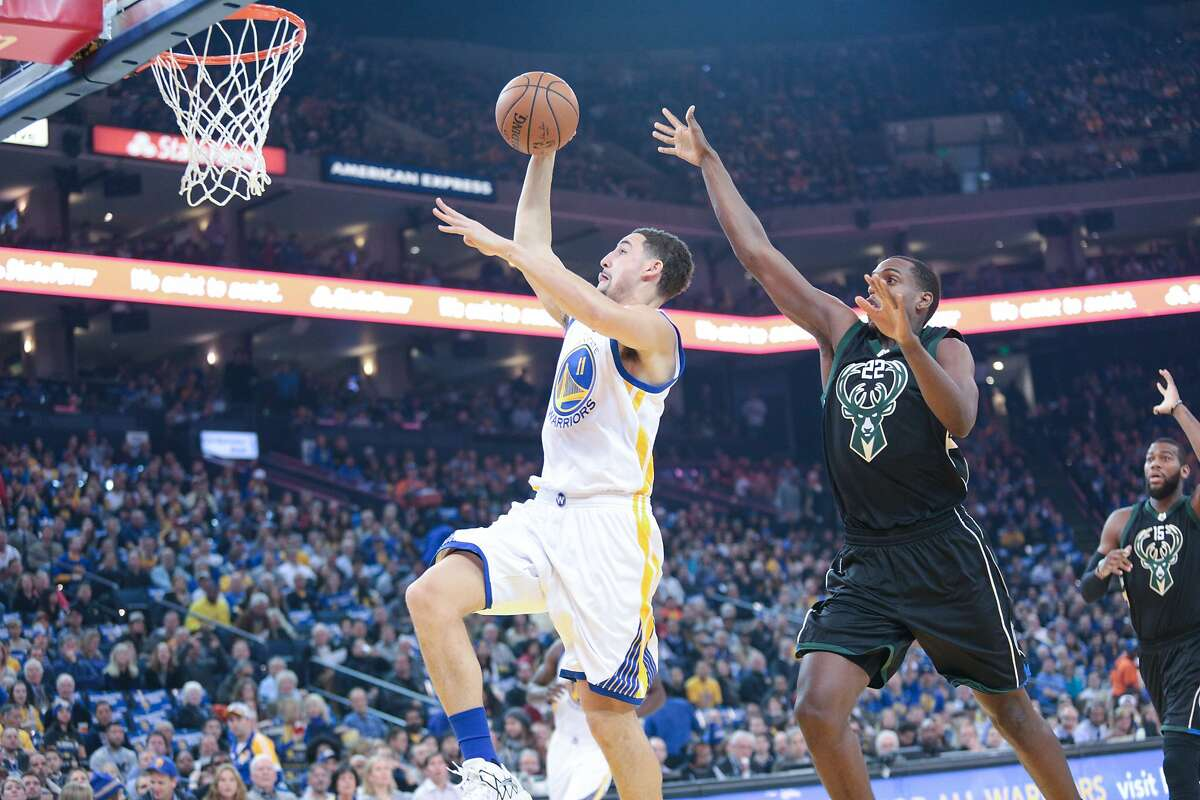 Golden State Warriors guard Klay Thompson (11) takes a shot against the Milwaukee Bucks during the first half of an NBA basketball game, Friday, Dec. 18, 2015, at Oracle Arena in Oakland, Calif.