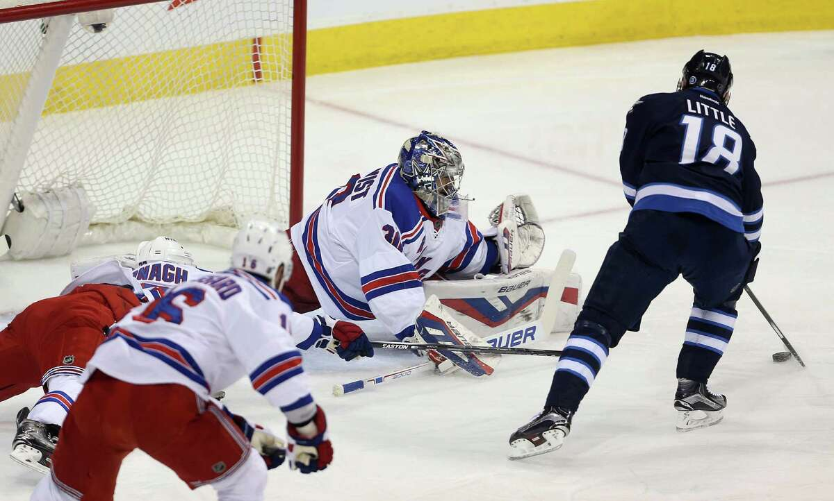 Winnipeg Jets' Bryan Little (18) opens the scoring as he puts the puck past New York Rangers goaltender Henrik Lundqvist (30) during the PIAA A championship football game Friday, Dec. 18, 2015, in Hershey, Pa. (Sean Simmers/PennLive.com PennLive.com via AP) ORG XMIT: WPGT101