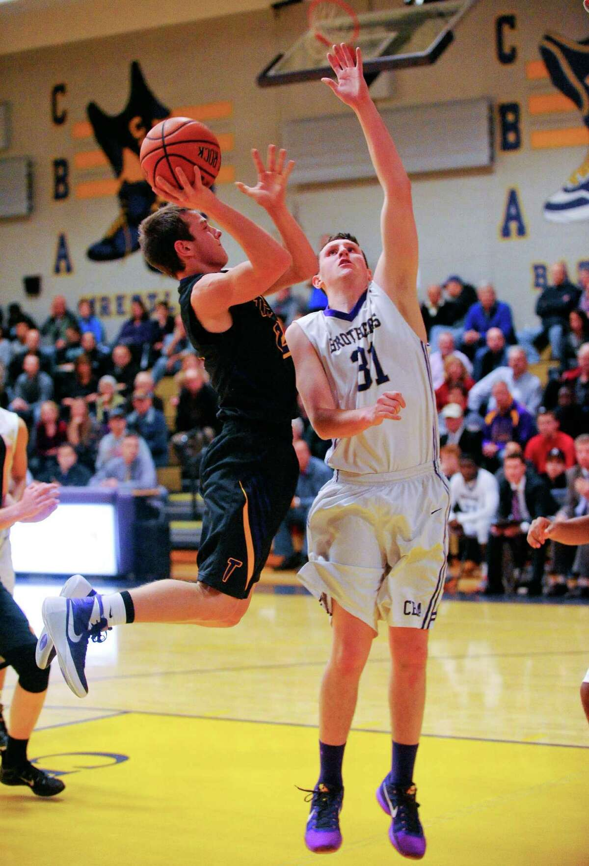 Troy's Ryan Carmello (2) puts up a shot against Christian Brothers Academy's Ian Schultz (31) during the first half of their boys' high school basketball game on Thursday, Dec. 18, 2015, in Colonie, N.Y. (Hans Pennink / Special to the Times Union) ORG XMIT: HP101