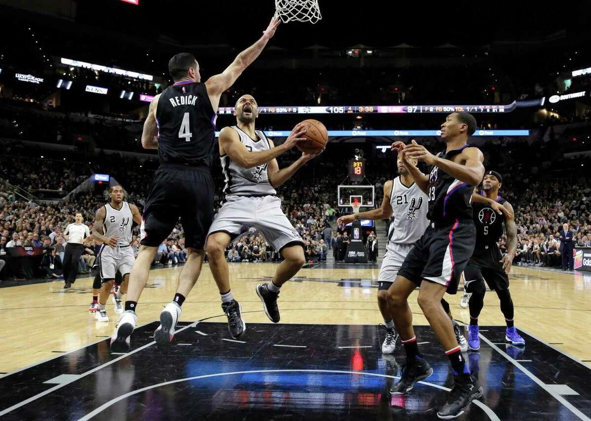 San Antonio Spurs guard Tony Parker shoots past Los Angeles Clippers guard J.J. Redick (4) during the second half of an NBA basketball game Friday, Dec. 18, 2015, in San Antonio. San Antonio won 115-107. (AP Photo/Eric Gay)