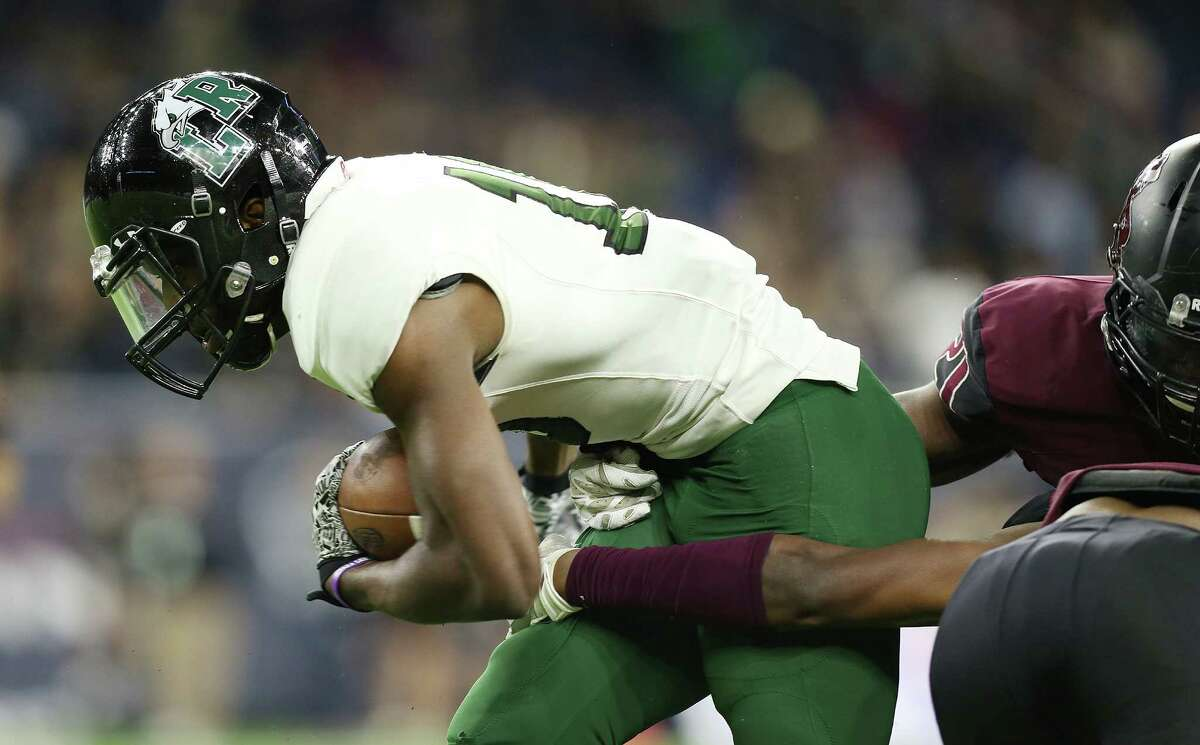 Mansfield Lake Ridge's Zach Jackson (10) muscles his way for extra yards in the second half of 5A Div. 1 championship football against Mansfield Lake Ridge on Friday, Dec. 18, 2015, in Houston. Richmond George Ranch won the game 56-0.