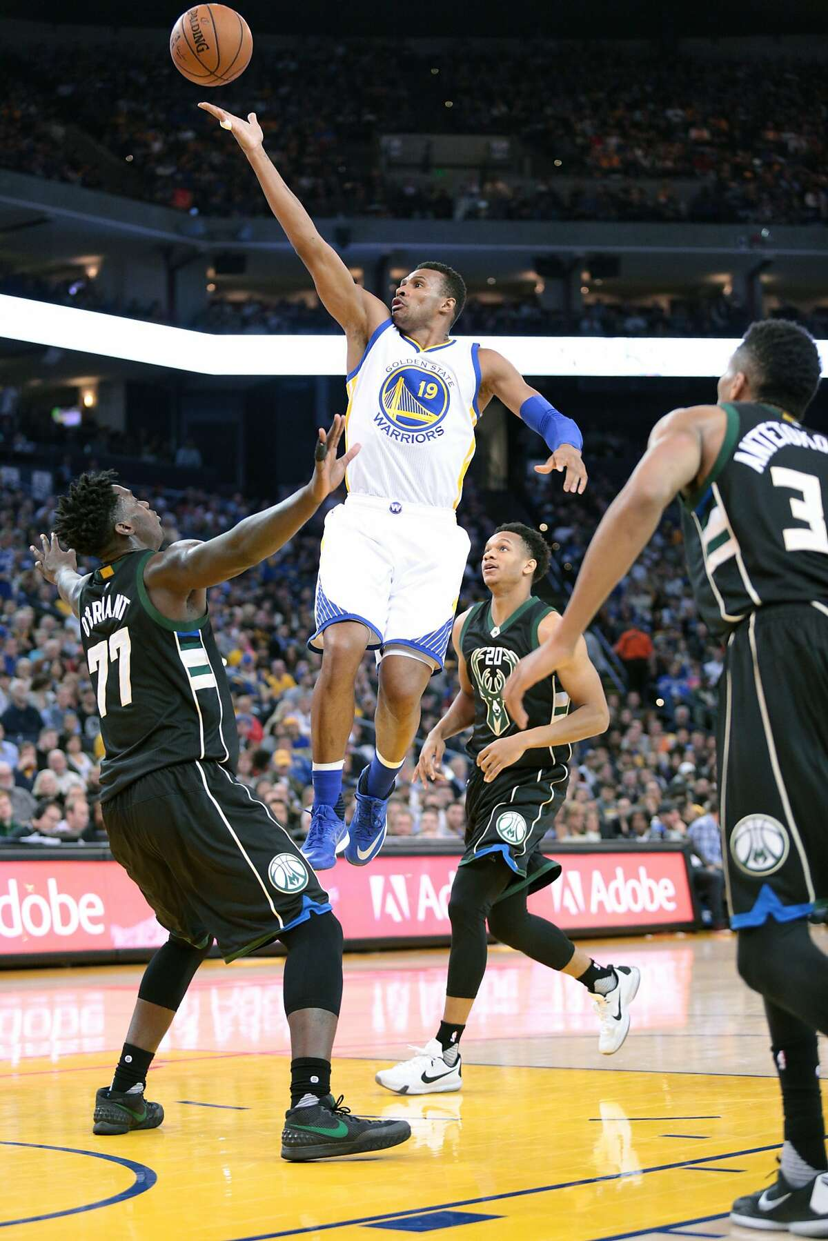 Golden State Warriors guard Leandro Barbosa (19) lays up a shot against Milwaukee Bucks forward Johnny O'Bryant III (77) during the first half of an NBA basketball game, Friday, Dec. 18, 2015, at Oracle Arena in Oakland, Calif.