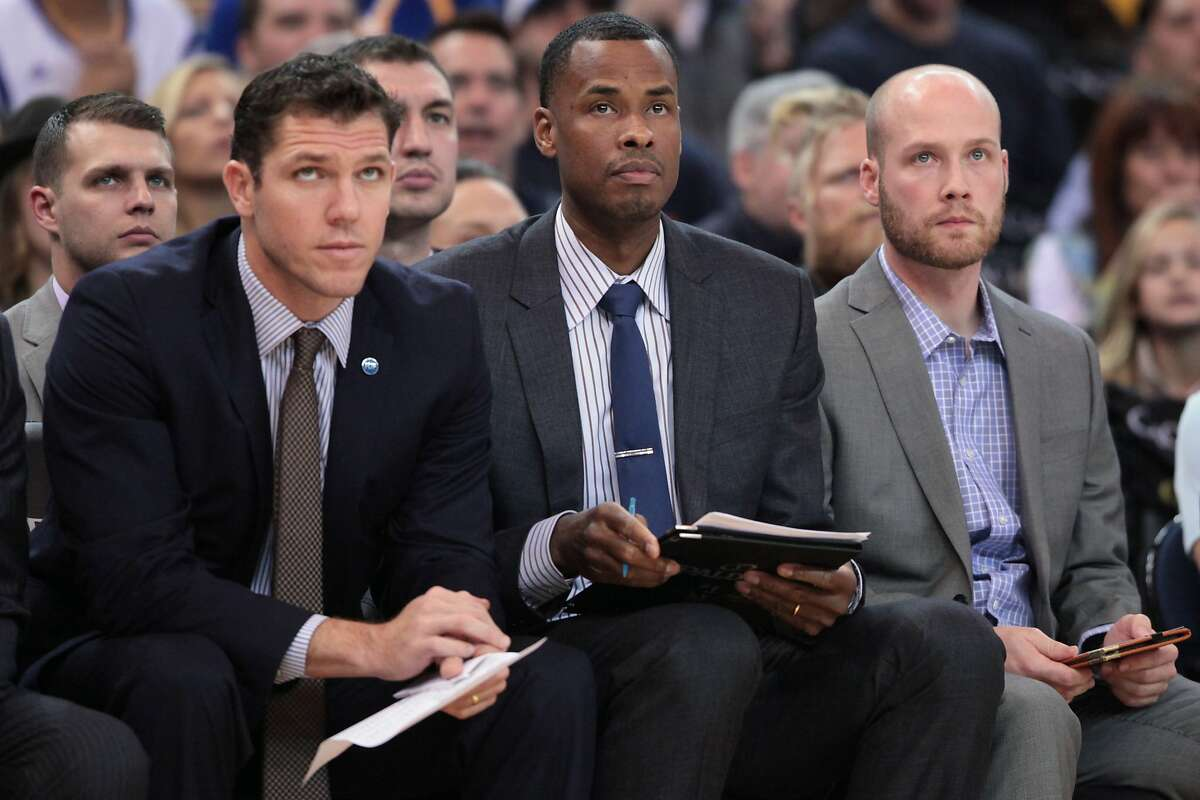 Golden State Warriors forward Harrison Barnes (40) (center) watches the game against the Milwaukee Bucks during the first half of an NBA basketball game, Friday, Dec. 18, 2015, at Oracle Arena in Oakland, Calif.