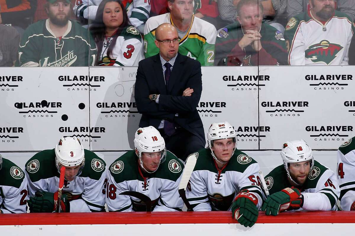 GLENDALE, AZ - DECEMBER 11: Head coach Mike Yeo of the Minnesota Wild looks on from the bench during the second period of the NHL game against the Arizona Coyotes at Gila River Arena on December 11, 2015 in Glendale, Arizona.