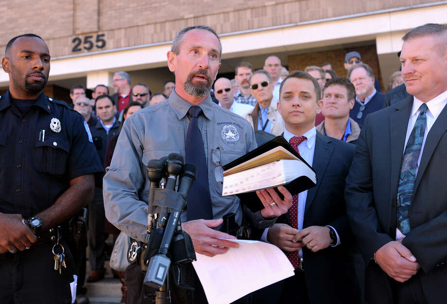 Burt More holds out a Bible during a press conference where several Beaumont Police officers expressed their concerns about being told they can no longer pray during their lunch break.  Photo taken Friday, December 18, 2015  Guiseppe Barranco/The Enterprise Photo: Guiseppe Barranco, Photo Editor