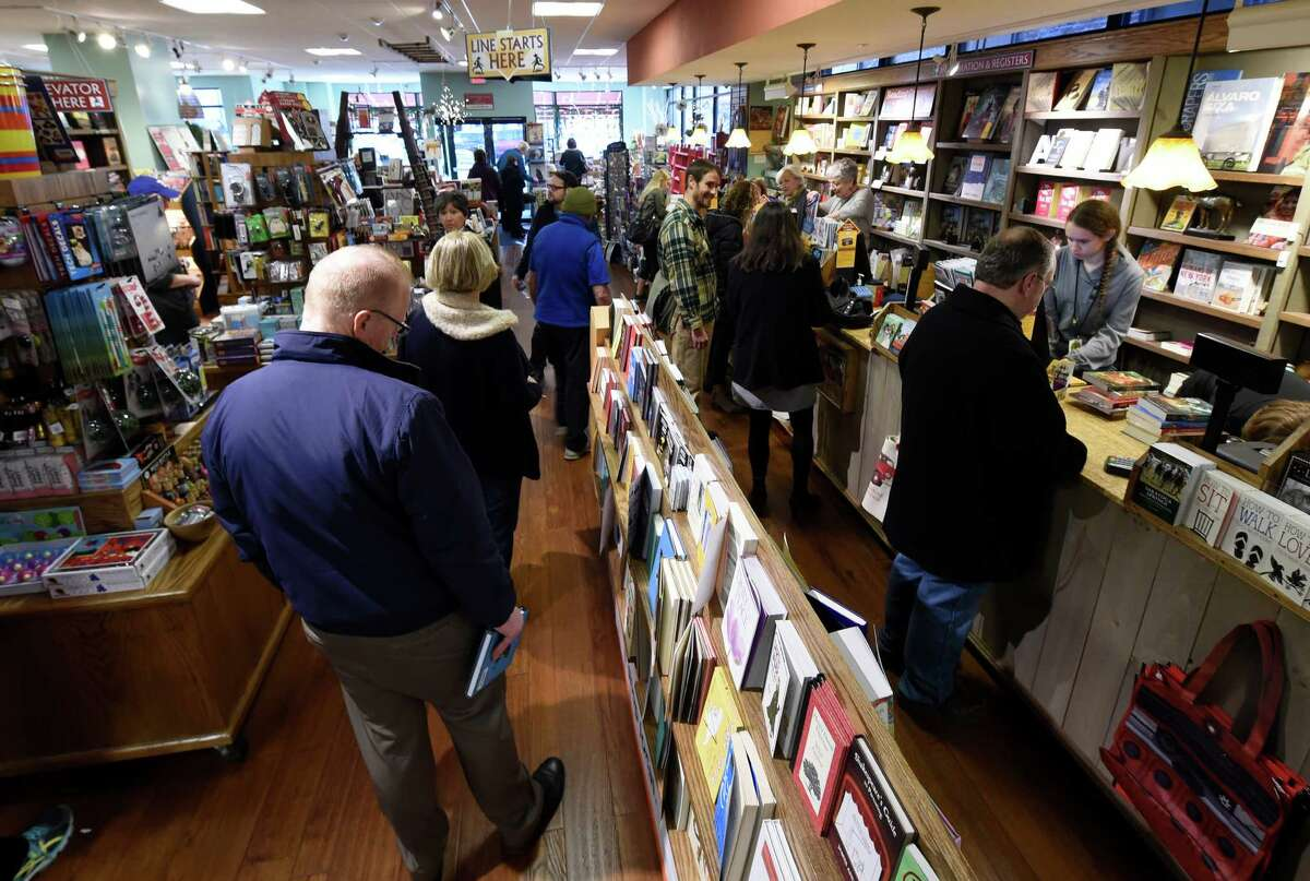 Shoppers stand in line to check out at the Northshire Bookstore Wednesday Dec. 16, 2015 in Saratoga Springs, N.Y. (Skip Dickstein/Times Union)