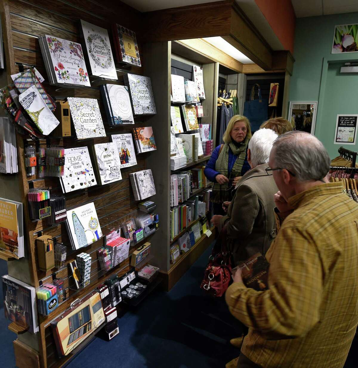 Shoppers look over a display of adult coloring books at the Northshire Bookstore Wednesday Dec. 16, 2015 in Saratoga Springs, N.Y. (Skip Dickstein/Times Union)