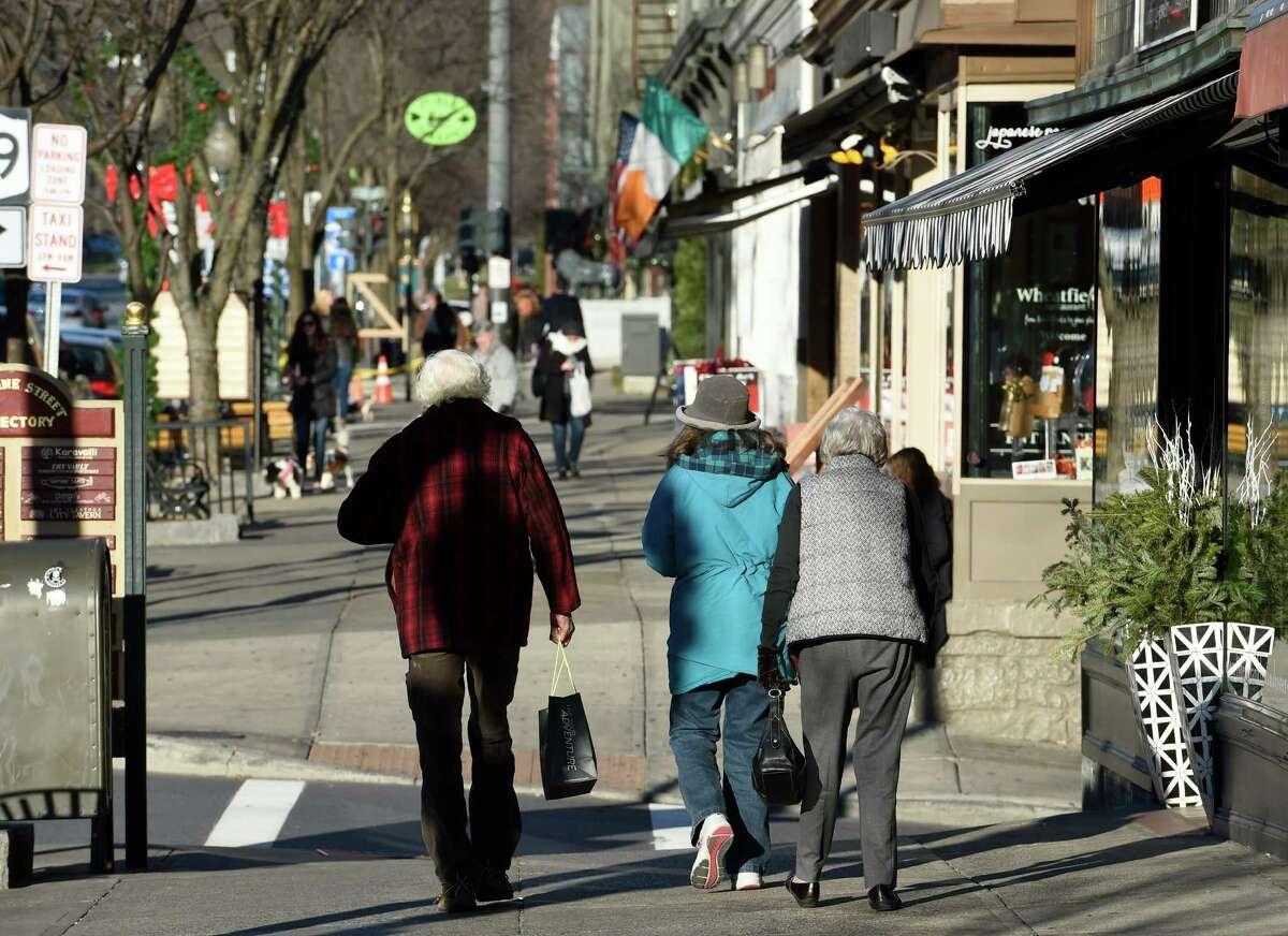 Shoppers walk on Broadway Wednesday Dec. 16, 2015 in Saratoga Springs, N.Y. (Skip Dickstein/Times Union)