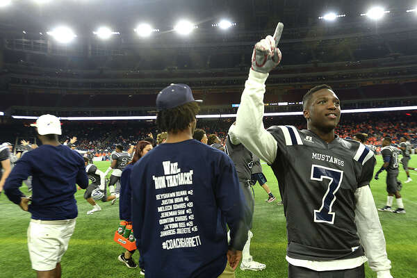 West Orange-Stark's players, including Malick Phillips, and coaches celebrate after defeating Celina 22-3 and earning the state championship during Friday's state finals game at NRG Stadium in Houston. Photo taken Friday, December 18, 2015 Kim Brent/The Enterprise
