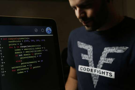 Co-founders Felix Desroches with a screen displaying a section of the coding test at their downtown San Francisco, Calif. office on Saturday December 19, 2015. Codefights is an online programming puzzle test for applicants who are applying for jobs at companies like Go Daddy, Uber and Dropbox to name just a few.