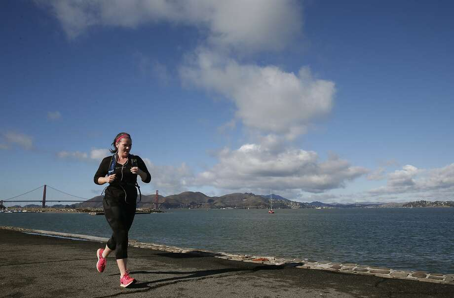 A jogger runs on the path along the bay at the Marina Green during the break between rainstorms in San Francisco, Calif. on Saturday, Dec. 19, 2015. The Bay Area dried out after heavy rains overnight Saturday but another soaker is expected to to dampen the region Sunday afternoon. Photo: Paul Chinn, The Chronicle