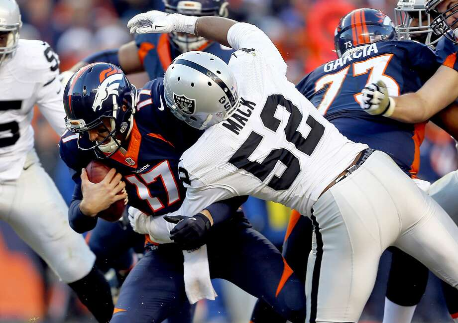 Denver Broncos quarterback Brock Osweiler (17) is sacked by Oakland Raiders defensive end Khalil Mack (52) during the second half of an NFL football game, Sunday, Dec. 13, 2015, in Denver. (AP Photo/Joe Mahoney) Photo: Joe Mahoney, Associated Press