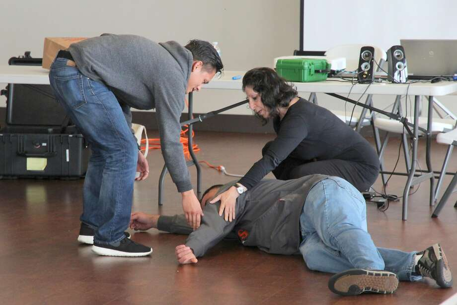 San Francisco Police Department (SFPD) officers in a role play to demonstrate verbal de-escalation techniques. Crisis Intervention Team (CIT) Training, October 2015. San Francisco Police Department (SFPD) Crisis Intervention Team (CIT) Training with SFPD Field Training Officers, October 13-16th, 2015, Harding Park, San Francisco, California. Photo: Courtesy David Elliott Lewis, Ph