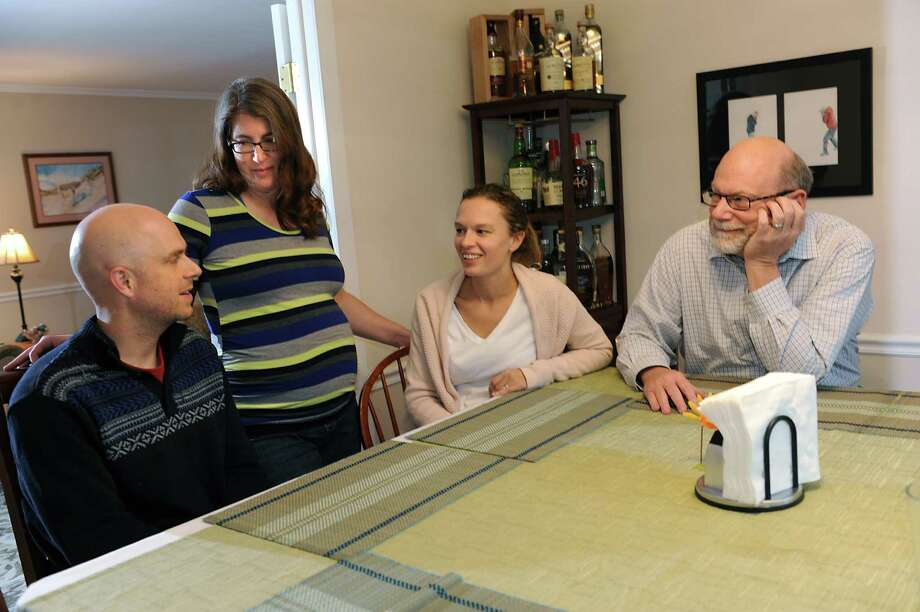 Ryan Levering, left, talks with his stepmother Abby, second from left, his wife Terrill and his father Bill at Bill and Abby's home on Friday, Nov. 27, 2015 in Niskayuna, N.Y. Abby is the gestational surrogate for her stepson and his wife. She is due in February. (Lori Van Buren / Times Union) Photo: Lori Van Buren / 10034439A