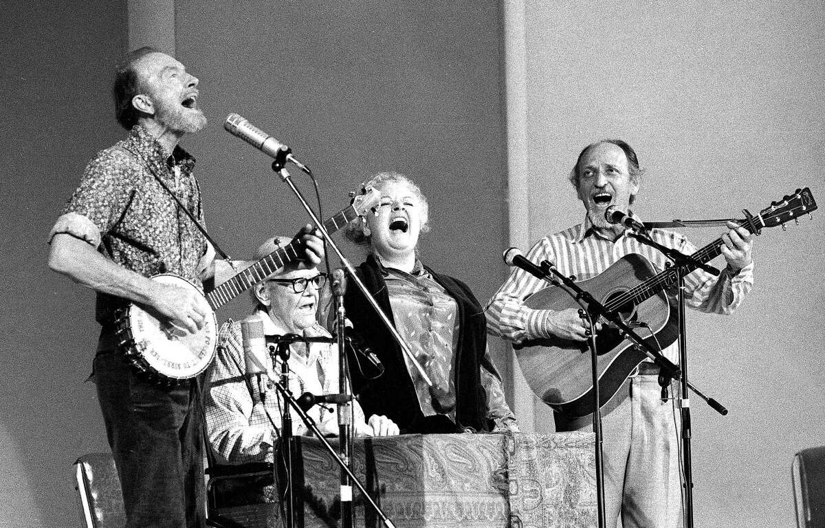 FILE - In this Nov. 28, 1980, file photo, the Weavers perform in a 25th Anniversary reunion concert at Carnegie Hall in New York. From left are: Pete Seeger, Lee Hays, Ronnie Gilbert and Fred Hellerman. Fred Hellerman, the last remaining member of the Weavers, died at his home in Weston, Conn. Thursday, September 1, 2016, his son confirmed.