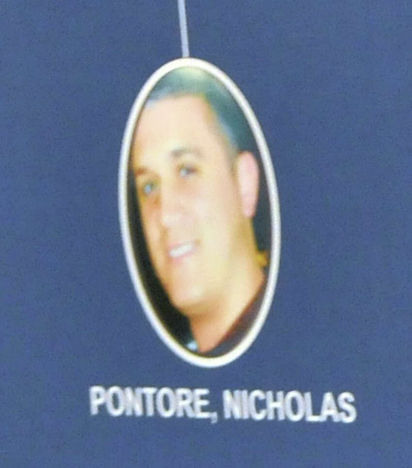 A photo of Nicholas Pontore is displayed during a press conference on Tuesday, Aug. 4, 2015, at The New York State Police Academy in Albany, N.Y. (Phoebe Sheehan/Times Union archive)
