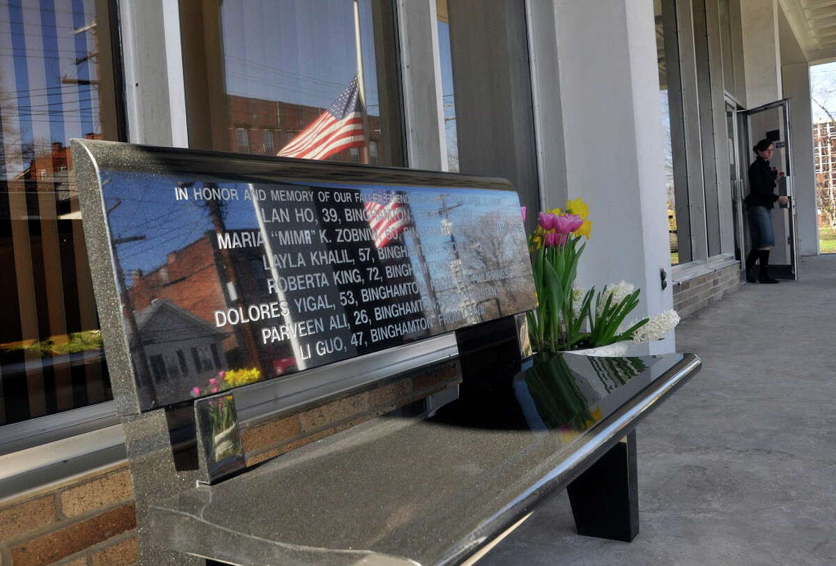 In this March 24, 2010 photo, one of two granite benches bearing the names, ages and countries of origin of the 13 victims of the April 3, 2009, shooting massacre at the American Civic Association in Binghamton, N.Y., greets visitors as they enter the newly renovated building. (AP Photo/Heather Ainsworth)