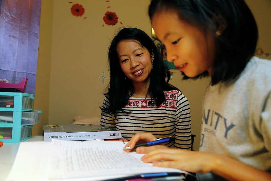 Cindy Wu home schools her children, including 10-year-old Alicia, in conjunction with Trinity Classical. 