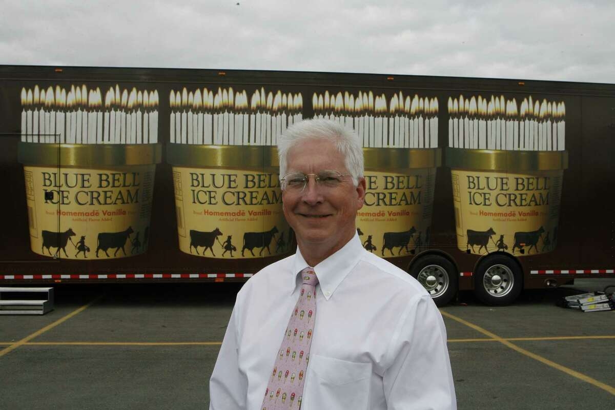 """12/28/06--Paul Kruse is CEO and President of Blue Bell Creameries. Behind him is the 18 wheel trailer truck that will tour next year as part of the 100th anniversary of Blue Bell. Blue Bell Ice Cream will celebrate its 100th anniversary next year. Included in the celebration will be a """"Days in the Country"""" sculpture garden at the Washington County Fairgrounds, a """"Name That Flavor"""" contest, an anniversary book about the history of Blue Bell, and an anniversary cookbook. There will also be an 18 wheel truck with Blue Bell exhibits that will tour 66 cities in the Blue Bell market area, Starting with Phoenix and Tucson, AZ. Photo by Steve Campbell, Chronicle Staff"""