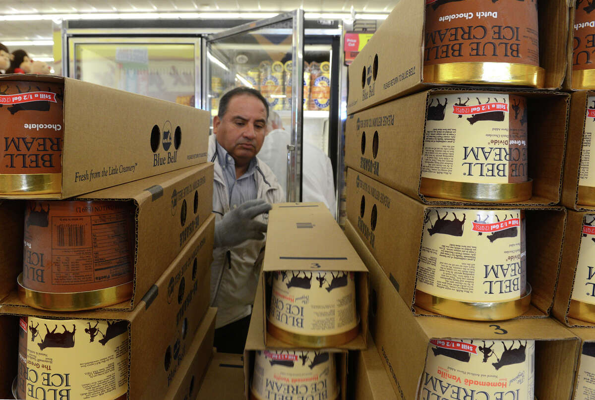 Robert Maldonado restocks Blue Bell containers last week at an Albertsons store in El Paso. Seven more Blue Bell flavors returned to grocery shelves Monday.