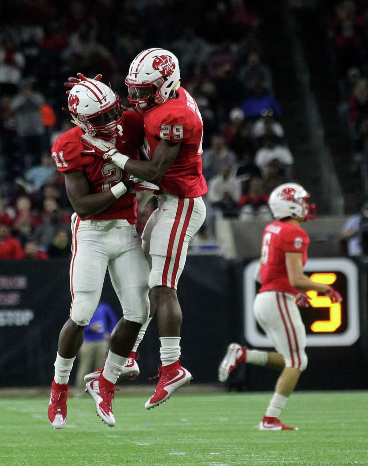 Katy's Tyler Pullig (21) celebrates his interception with DC Blades (29) in the first half of 6A Division II championship football game between Katy and Austin Lake Travis at NRG Stadium on Saturday, Dec. 19, 2015, in Houston.