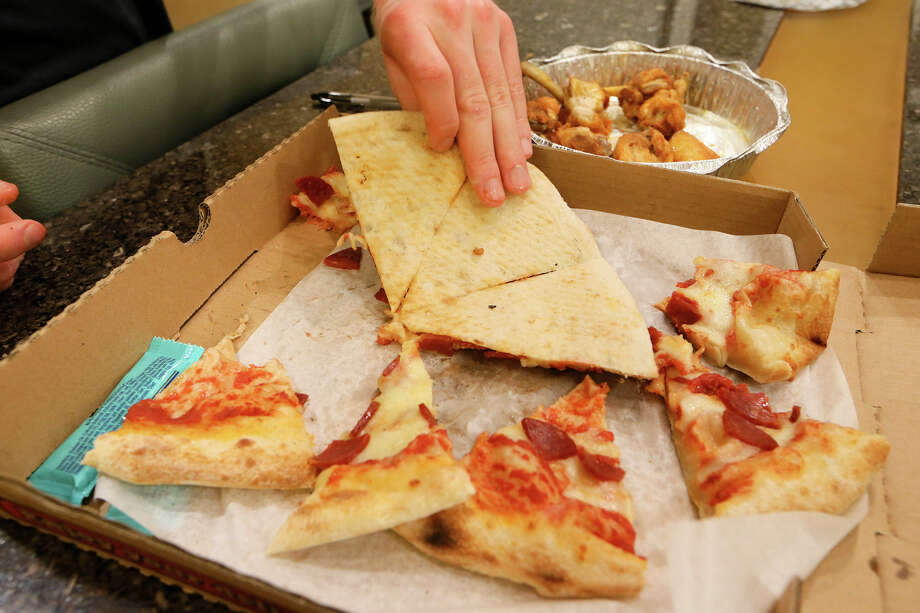 """Scott Payne called the pizza from Il Villaggio Pizzaria, which he found through a flier slid beneath his hotel door in San Antonio, """"an abomination."""" A string of restaurants is under review for delivering poor-quality food to tourists.  Photo: Marvin Pfeiffer, Staff / Express-News 2015"""