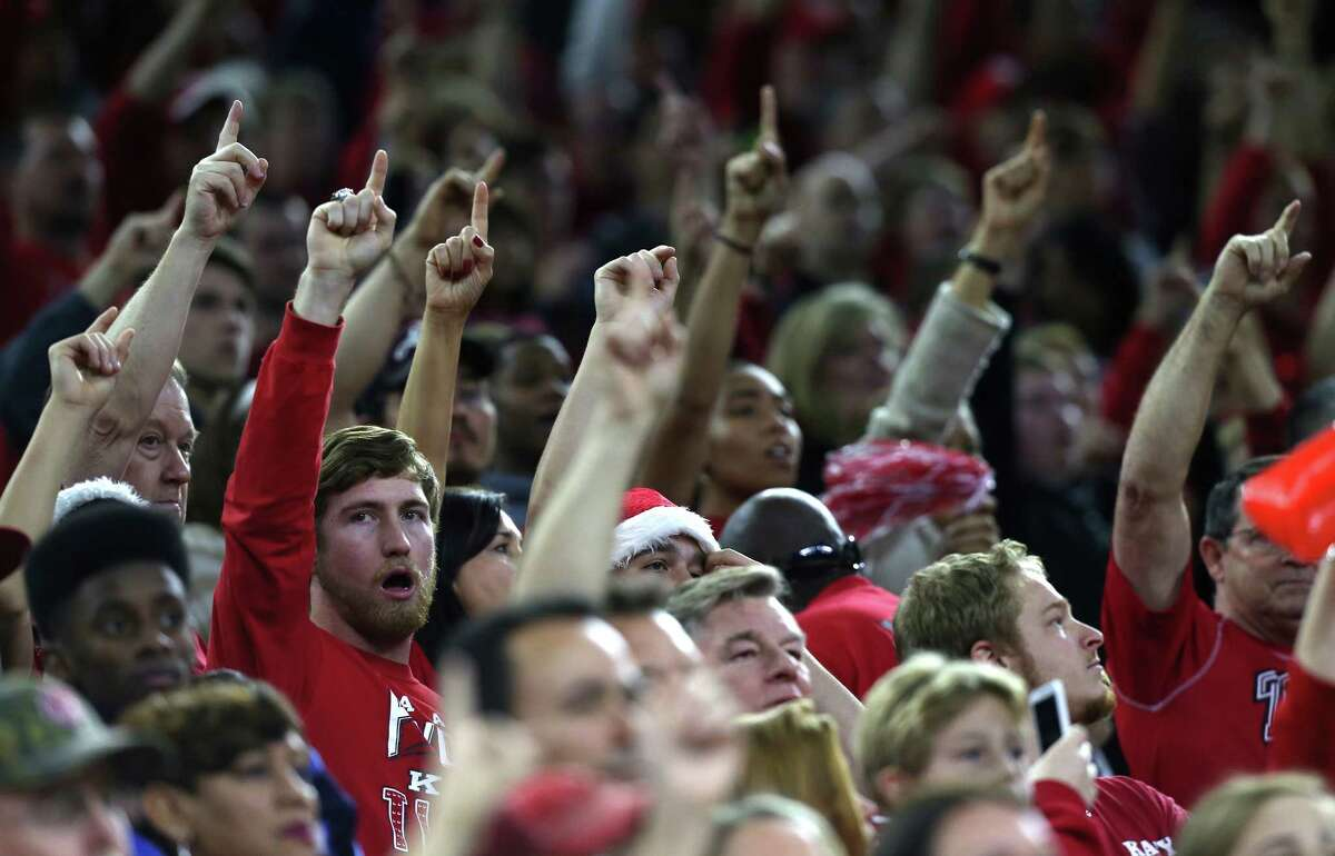 Katy football team fans hold up a finger during a kick off in the first half of 6A Division II championship football game between Katy and Austin Lake Travis at NRG Stadium on Saturday, Dec. 19, 2015, in Houston.