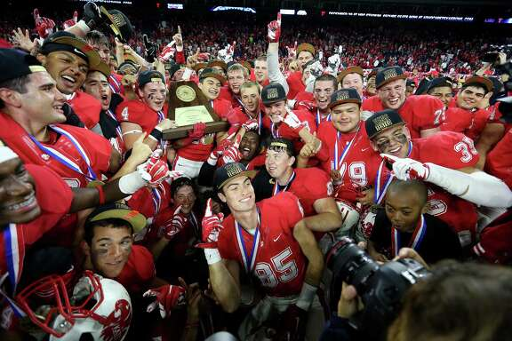 Katy's football team celebrates it's 34-7 win over Austin Lake Travis for the 6A Division II championship football game at NRG Stadium on  Saturday, Dec. 19, 2015, in Houston.  Katy won the title 34-7.