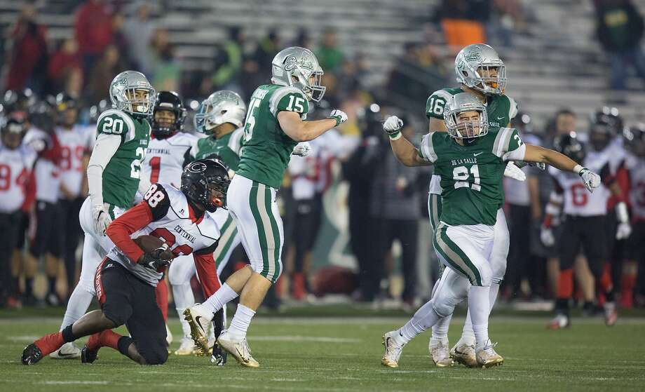 De La Salle Spartans defensive back Nick Lopez (21) celebrates after a tackle against Centennial Huskies wide receiver Javon Mckinley (88) during the second half of the CIF Open Division state championship football game, Saturday, Dec. 19, 2015, at Hornet Stadium in Sacramento, Calif. Photo: Santiago Mejia, Special To The Chronicle