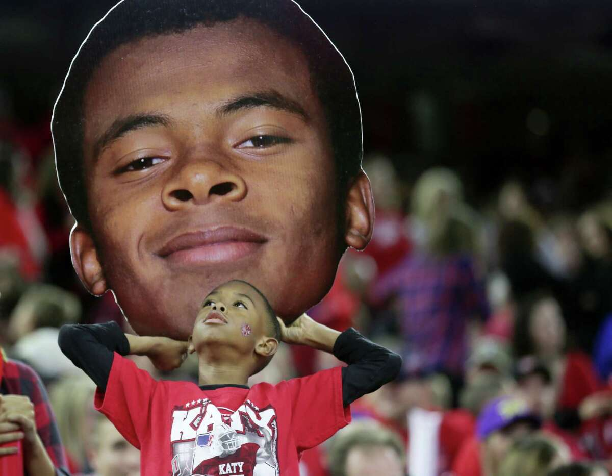 Aderian Jones, 7, holds up a sign of Katy High School football player Tony Mullins during the 6A Division II State Championship football game at NRG Stadium Saturday, Dec. 19, 2015, in Houston.