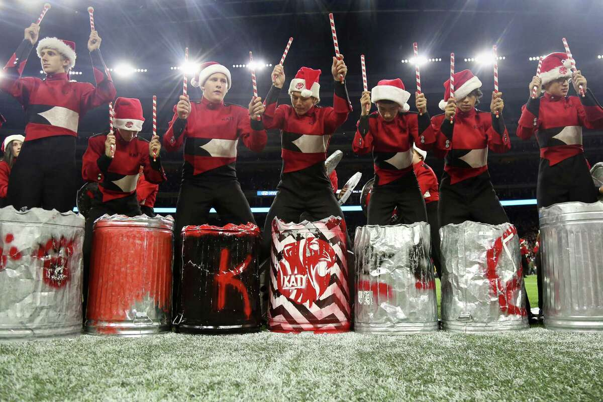 The Katy High School Trash Can Band performs during halftime of the 6A Division II State Championship football game at NRG Stadium Saturday, Dec. 19, 2015, in Houston.