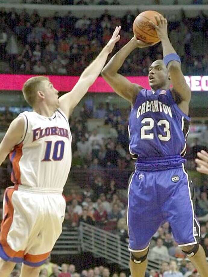 Bridgeport native Terrell Taylor puts up the game-winning shot over Brett Nelson in double overtime to help Creighton upset Forida, 83-82, in the 2002 NCAA Tournament Midwest Regional first round. Photo: AP File Photo