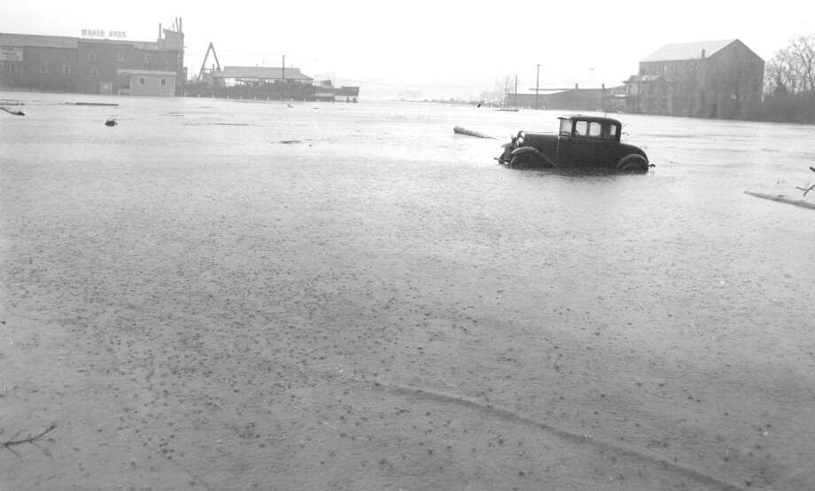 Contributed photo from the Gotch Collection, Greenwich Library. A Model T was trapped in the flood down by Steamboat Road and Arch Street during the 1938 Hurricane. Photo: Gotch Collection/Greenwich Library, Contributed Photo / Greenwich Citizen