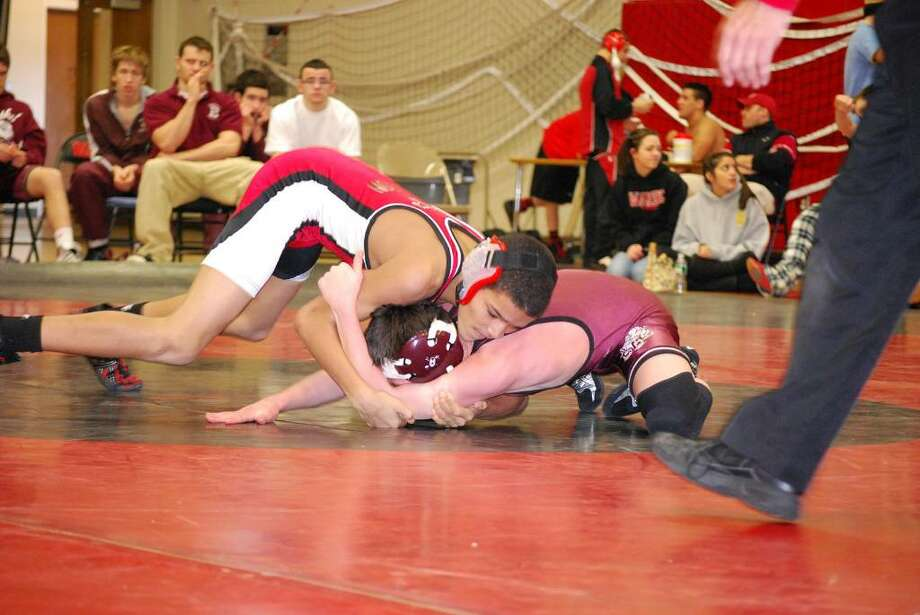 Warde's Pharoh Eaton takes control of a match in a regular season match at Fairfield Warde High School. Eaton is one of the nine members of the Warde team whose wrestling career started as a member of the PAL wrestling program Photo: Contributed Photo