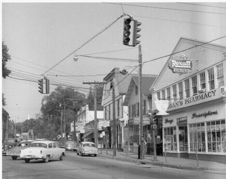 "Westport's Main Street and Post Road as seen in the 1950s. The time period of this photo is the emphasis of the documentary ""End of An Era - Westport in the 1950s"" premiering at the Westport Public Library on April 6 at 2 p.m. and April 7 at 7 p.m. Photo: Contributed Photo / Westport News"