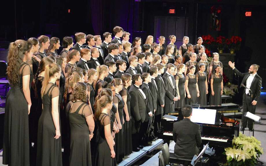 Singers at Staples High School's 75th anniversary Candlelight Concert earn thunderous applause from the audience at Saturday night's performance. Photo: Jarret Liotta / For Hearst Connecticut Media / Westport News