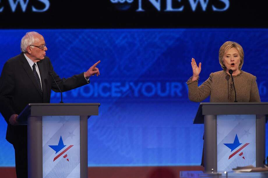 Bernie Sanders and Hillary Rodham Clinton offer contrasting approaches to national security. Photo: Jewel Samad, AFP / Getty Images