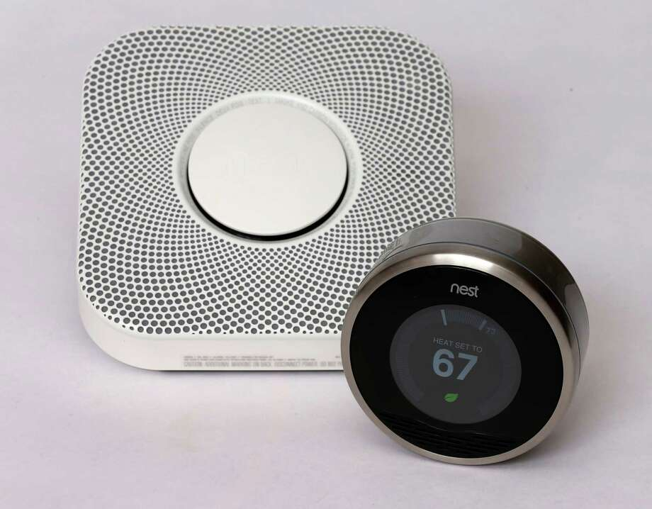 In this photo illustration, a Nest thermostat (R) and a smoke/carbon monoxide detector is seen on January 16, 2014 in Provo, Utah. Health officials recommend installing carbon monoxide detectors on every floor of the home. Photo: George Frey / Getty Images / 2014 Getty Images