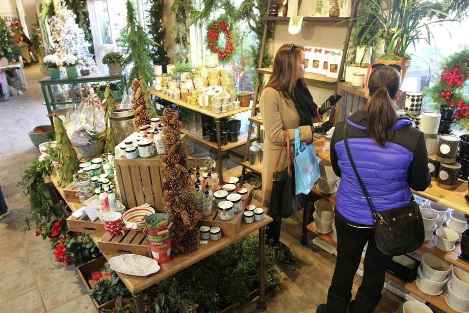 Holiday shoppers browse McArdle's Florist and Garden center for last minute gifts during the last weekend of holiday shopping in Greenwich, Conn. on Dec. 20, 2015. As the Holiday season winds down, children still have til Christmas Eve to visit Santa's workshop at McArdle's and have their photo taken with Santa. Photo: Matthew Brown, For Hearst Connecticut Media / Connecticut Post Freelance