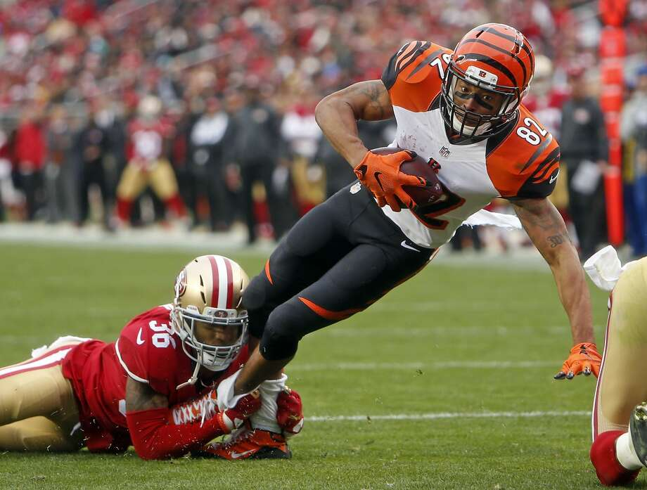 San Francisco 49ers' Dontae Johnson tackles Cincinnati Bengals' Marvin Jones in 2nd quarter during NFL game in Santa Clara, Calif., on Sunday, December 20, 2015. Photo: Scott Strazzante, The Chronicle