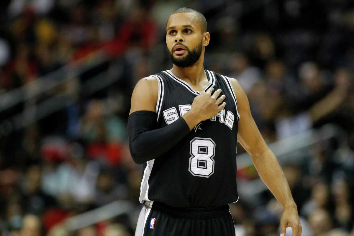 San Antonio Spurs' Patty Mills in action in the first half of an NBA basketball game against the Atlanta Hawks, Saturday, Dec. 12, 2015, in Atlanta. (AP Photo/Brett Davis)