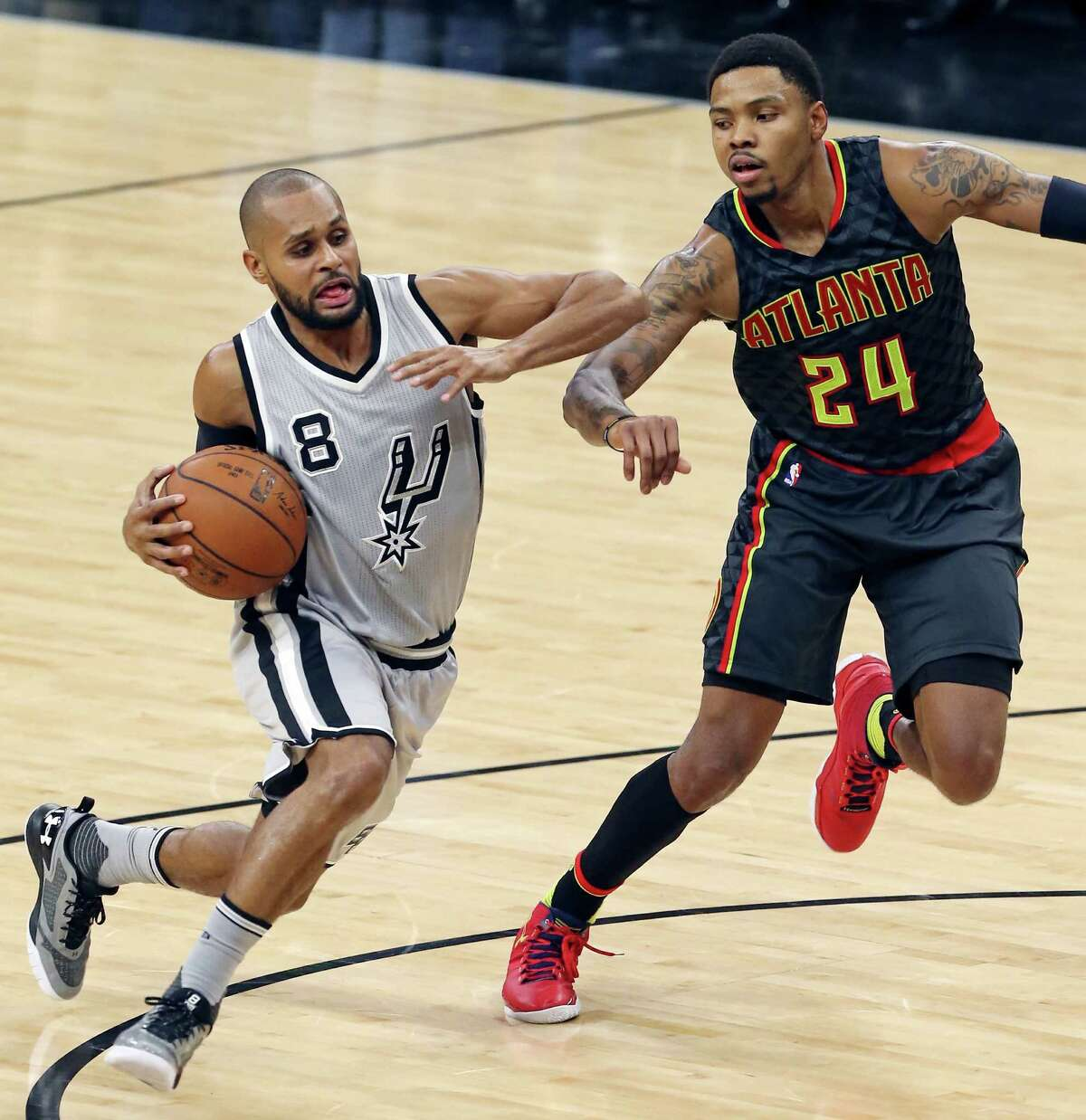 San Antonio Spurs' Patty Mills drives around Atlanta Hawks' Kent Bazemore during second half action Saturday Nov. 28, 2015 at the AT&T Center. The Spurs won 108-88.