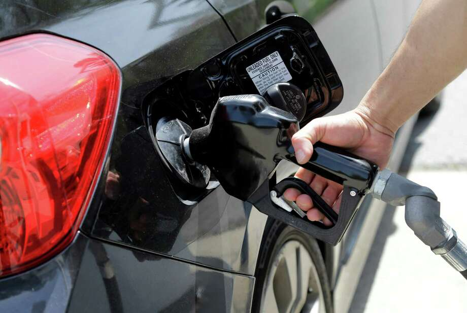 Plummeting crude oil prices have translated to gasoline prices that are near a six-year low. Photo: Associated Press File Photo / AP