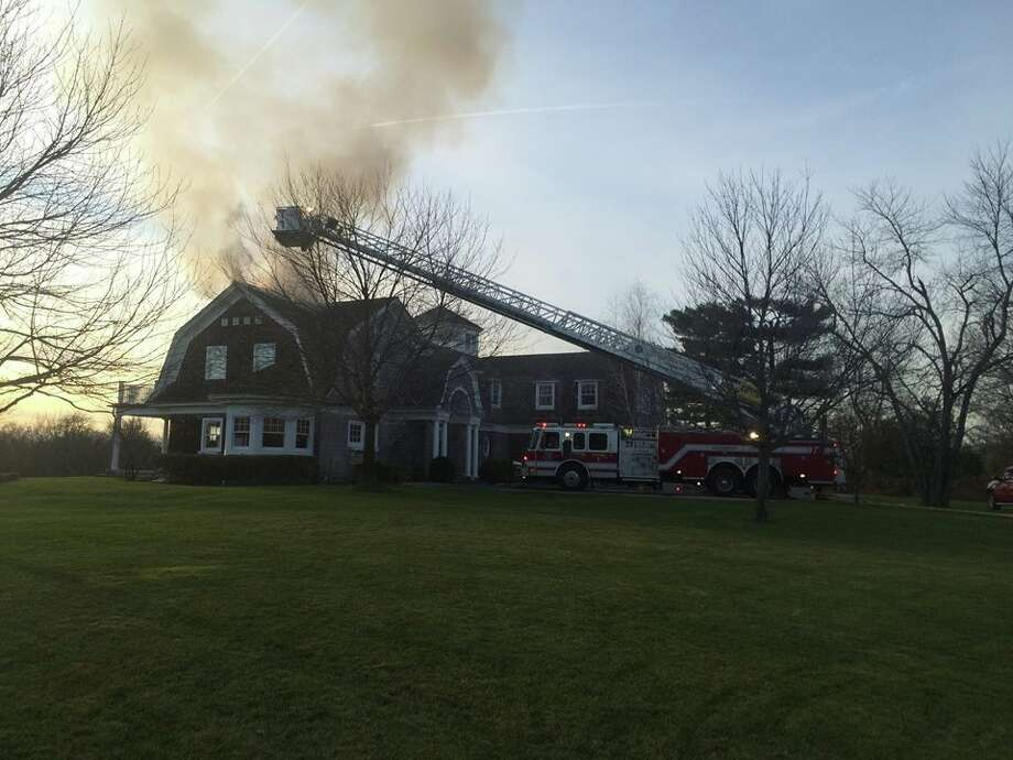 Greenwich firefighters knocked down a chimney and attic fire at a Riversville Road residence Sunday afternoon. No one was injured in the blaze. Photo: Contributed / Contributed / Connecticut Post