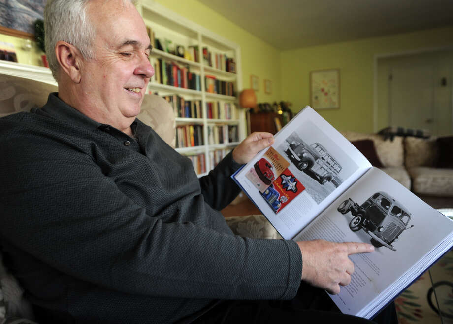 """Pat Foster leafs through his latest book, """"International Harvester Trucks: The Complete History,"""" at his home in Milford, Conn. on Wednesday, December 16, 2015. Photo: Brian A. Pounds / Hearst Connecticut Media / Connecticut Post"""